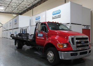 A UNIT truck unloading a UNIT from an Alamo customer's house, for controlled climate storage.